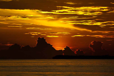 sunset picture telos islands indonesia surf trip waves
